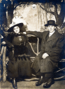 Royalty Free Photo of a Couple Sitting on a Park Bench
