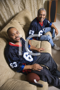 Royalty Free Photo of a Father and Son Wearing Matching Football Jerseys