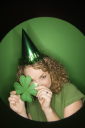 Royalty Free Photo of a Woman Wearing a Party Hat and Shamrock