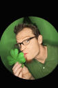 Royalty Free Photo of a Vignette of a Man Wearing a Saint Patrick's Day Hat and Kissing a Shamrock