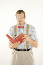 Royalty Free Photo of a Man Dressed Like a Nerd Reading a Book