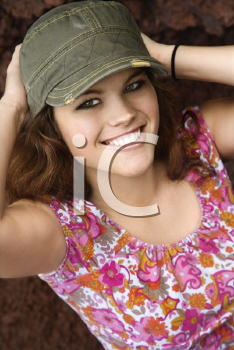 Royalty Free Photo of a Smiling Woman Wearing a Hat