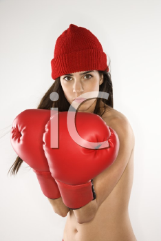 Topless caucasian woman wearing boxing gloves and hat.