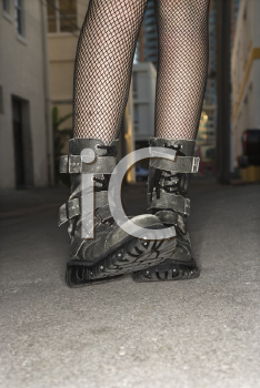 Royalty Free Photo of Legs and Feet Wearing Boots in an Urban Setting
