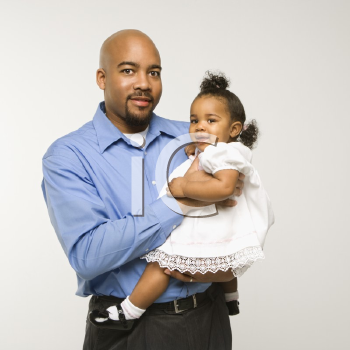 Royalty Free Photo of a Man Holding His Infant Daughter