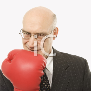 Royalty Free Photo of a Businessman Holding Up His Arm While Wearing Boxing Gloves