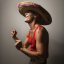 Royalty Free Photo of a Man Wearing a Sombrero and Snapping His Fingers