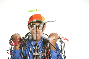 Royalty Free Photo of Businessman Wrapped in Computer Cables Wearing a Propeller Hat