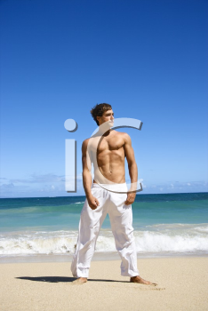 Royalty Free Photo of a Handsome Man Standing on Maui, Hawaii Beach
