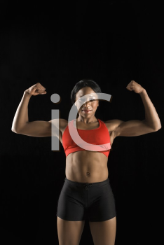 Royalty Free Photo of a Muscular Woman Wearing Athletic Apparel With Biceps Flexed