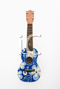 Royalty Free Photo of a Ukulele Painted With Blue Flowers