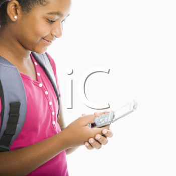 Royalty Free Photo of a Girl With Backpack Sending a Text Message From a Cellphone