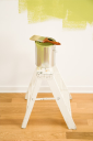 Royalty Free Photo of a Paintbrush Resting on a Paint Can on a Step Ladder