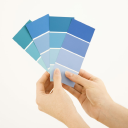 Royalty Free Photo of a Woman Holding Paint Color Swatches