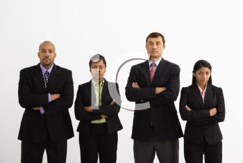 Royalty Free Photo of a Businesspeople Standing With Arms Crossed Looking Serious