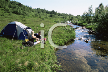 Royalty Free Photo of a Couple Camping By a Stream