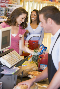 Royalty Free Photo of Women at the Checkout in a Grocery Store