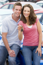 Royalty Free Photo of a Couple Holding the Keys to a New Car