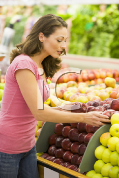 Royalty Free Photo of a Woman Shopping for Apples