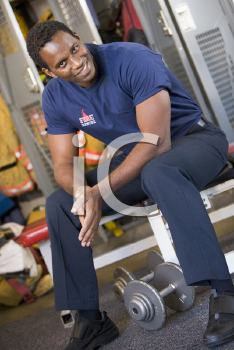 Royalty Free Photo of a Firefighter in the Locker Room