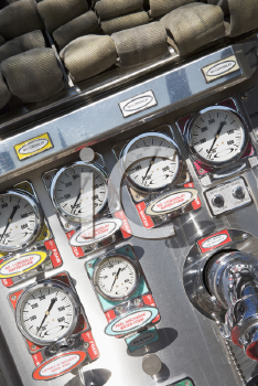 Royalty Free Photo of Fire Hoses and Pressure Gauges in a Firetruck
