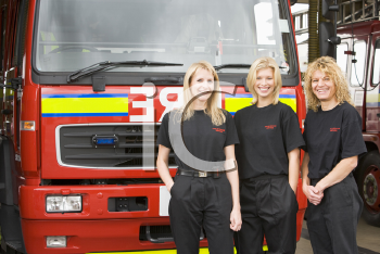Royalty Free Photo of Three Female Firefighters in Front of the Truck