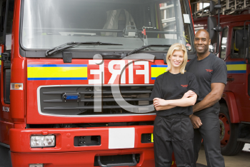 Royalty Free Photo of Two Firefighters in Front of the Truck