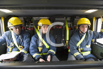 Royalty Free Photo of Firefighters in the Truck