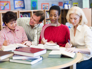 Royalty Free Photo of Three Women and a Man in a Library