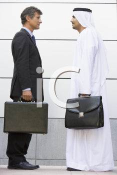 Royalty Free Photo of Two Men of Different Cultures With Briefcases