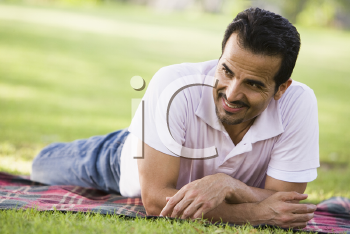Royalty Free Photo of a Man Lying on the Grass