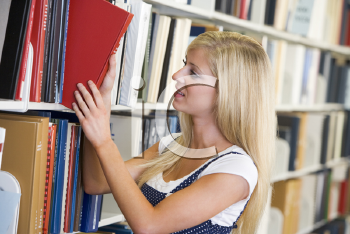 Royalty Free Photo of a Girl in a Library