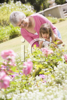 Royalty Free Photo of a Grandmother and Granddaughter in the Garden