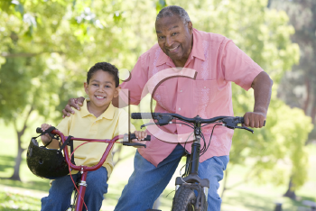 Royalty Free Photo of a Man and His Grandson on Bikes