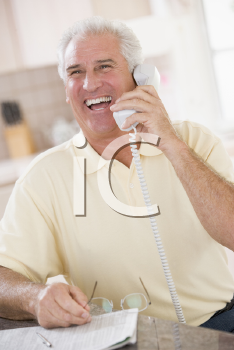 Royalty Free Photo of a Man on the Telephone Laughing