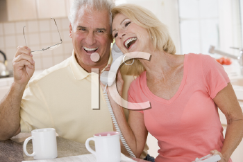 Royalty Free Photo of a Couple Talking on the Phone