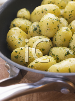Royalty Free Photo of Buttered New Potatoes With Parsley