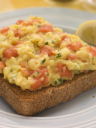 Royalty Free Photo of Scrambled Egg and Smoked Salmon on Brown Toast