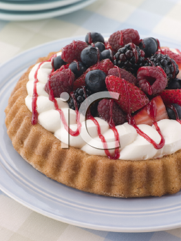 Royalty Free Photo of a Whipped Cream and Berry Sponge Flan