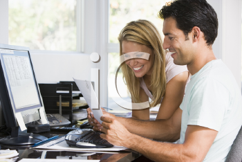 Royalty Free Photo of a Couple With a Computer