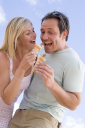 Royalty Free Photo of a Couple Eating Ice Cream