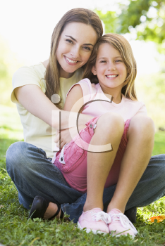 Royalty Free Photo of a Mother Hugging Her Daughter