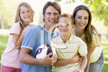 Royalty Free Photo of a Family Outside With a Ball