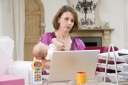 Royalty Free Photo of a Mother and Baby in a Home Office