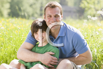 Royalty Free Photo of a Father and Son in a Field