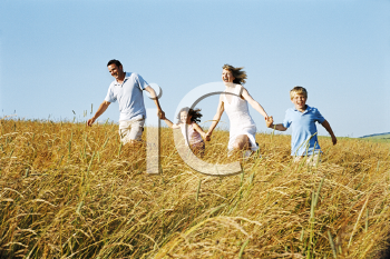 Royalty Free Photo of a Family Running