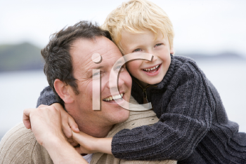 Royalty Free Photo of a Father and Son at the Beach