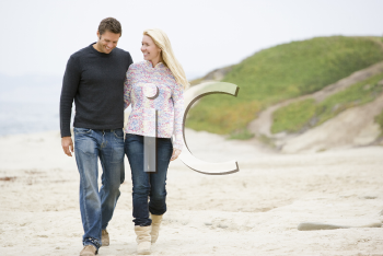 Royalty Free Photo of a Couple Walking on the Beach