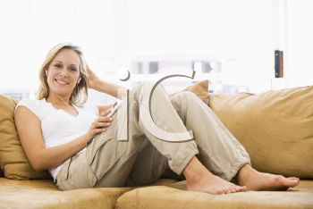 Royalty Free Photo of a Woman Living to an MP3 Player