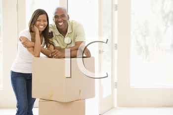 Royalty Free Photo of a Couple Leaning on a Box